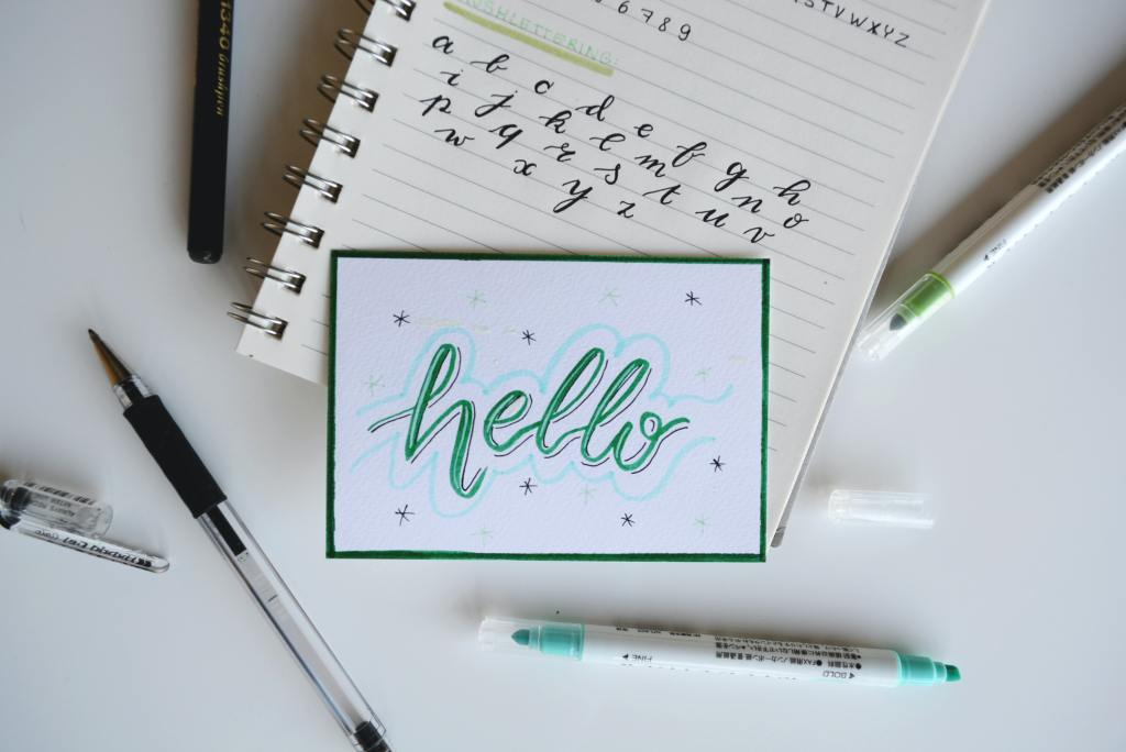 White and green hello board decor - Photo by Estée Janssens on Unsplash