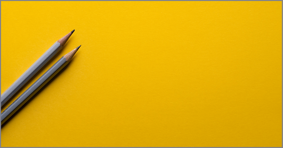 Two grey pencils on a yellow background - Photo by Joanna Kosinska on Unsplash