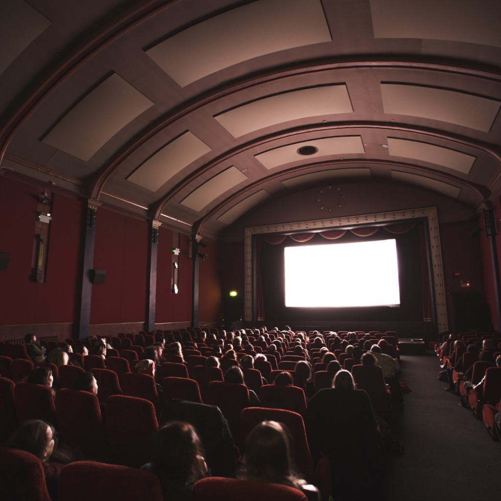 Audience in a cinema screen - Photo by Jake Hills on Unsplash